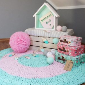 A one-of-a-kind addition to timeless interiors, the Mint and Pink Children Crochet Rug offers a relaxed comfortable feel of elegance for the modern home. This nursery rug will stand out bold and bright against your floor and bring a quirky and charming vibe to your home.