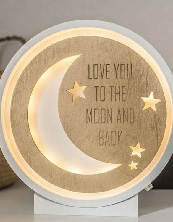 Perfect for setting a calm moon in your kid's bedroom, the Moon Decorative Wood Night Light gives a soft glow when turned on.