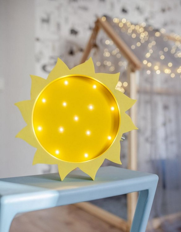 Perfect for setting a calm moon in your kid's bedroom, the Sun Decorative Night Light gives a soft glow when turned on.