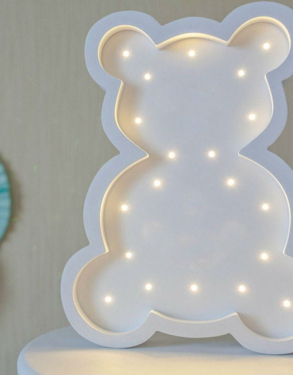 Perfect for setting a calm moon in your kid's bedroom, the White Teddy Bear Decorative Night Light gives a soft glow when turned on.
