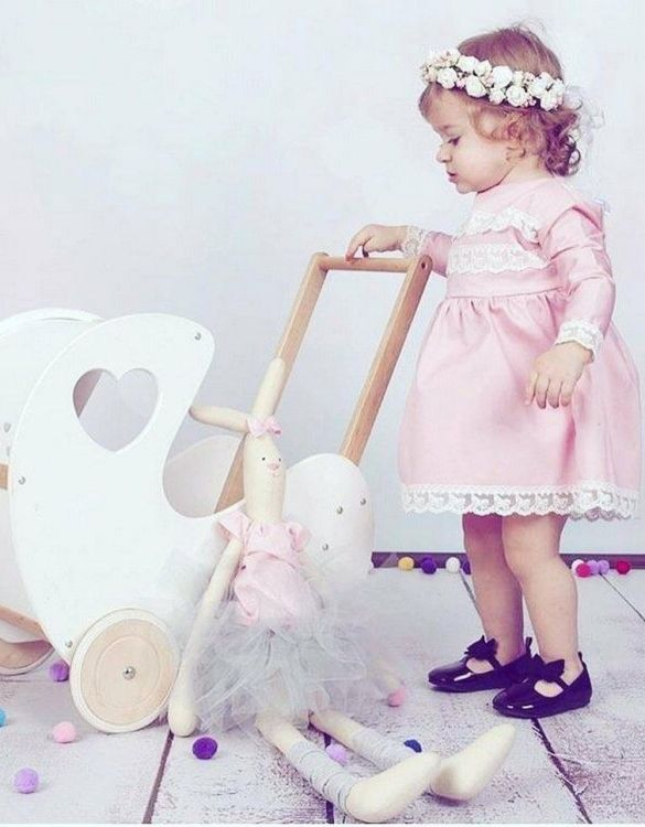 Perfect for taking dolly or teddy for a walk, the Handmade Wooden Doll Pram Heart White & Natural Wood will parkle your child's imagination and create hours and hours of play! This gorgeous wooden pram is perfect for little girls to take their favourite dolls for a ride, it has rubber wheels and is suited to younger children.