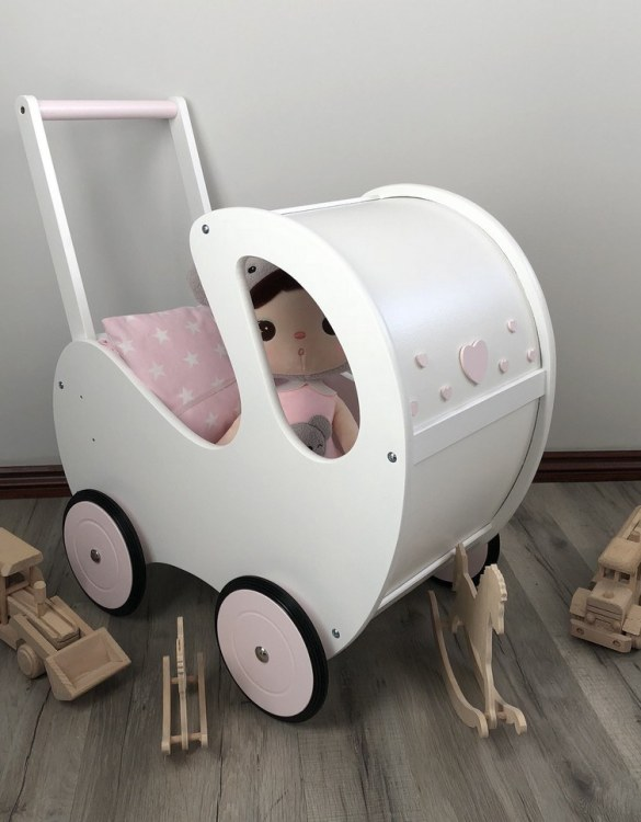 Perfect for taking dolly or teddy for a walk, the Handmade Wooden Doll Pram Maya will parkle your child's imagination and create hours and hours of play! This gorgeous wooden pram is perfect for little girls to take their favourite dolls for a ride, it has rubber wheels and is suited to younger children.