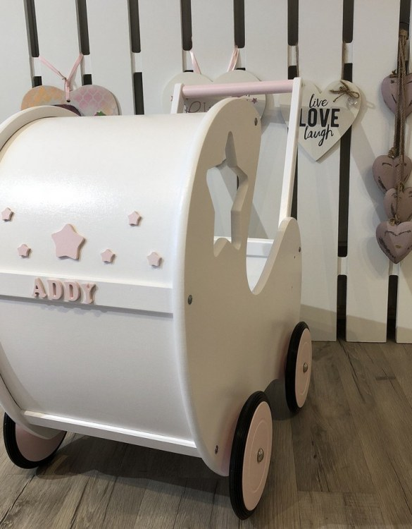 Perfect for taking dolly or teddy for a walk, the Handmade Wooden Doll Pram Star White will parkle your child's imagination and create hours and hours of play! This gorgeous wooden pram is perfect for little girls to take their favourite dolls for a ride, it has rubber wheels and is suited to younger children.