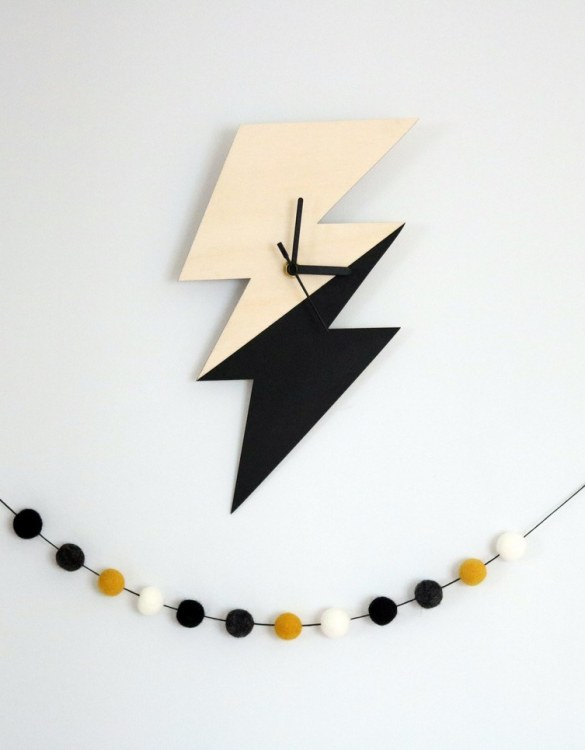 Can be hung up on a wall or placed on a shelf the Decorative Wall Clock - Bolt will make learning to tell the time lots of fun for young children. This bedroom wall clock looks amazing on the wall of a daughter, son, grandchild, or godchild's playroom, bedroom or nursery.