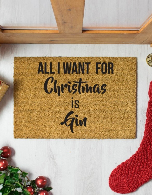 Keep carpets clean and welcome guests with the All I want for Christmas is Gin. This stunning doormat design will do the greeting for you and will brighten up your front porch or entrance hall with some colour, what more could you ask for!