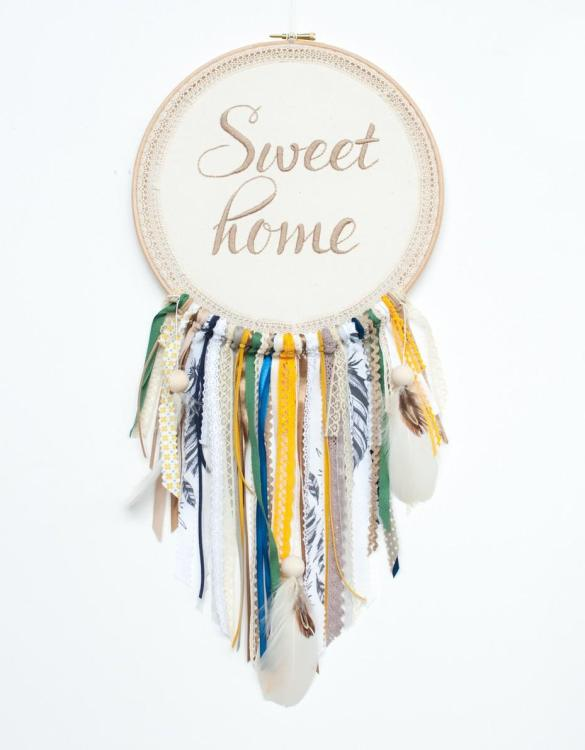 Perfect for a nursery or child's bedroom, the Beige Sweet Home Handmade Dream Catcher looks great as a new baby gift or to hang in the baby's nursery. Dream catchers are totems that represent good energy, and neutralize negative energy at home.