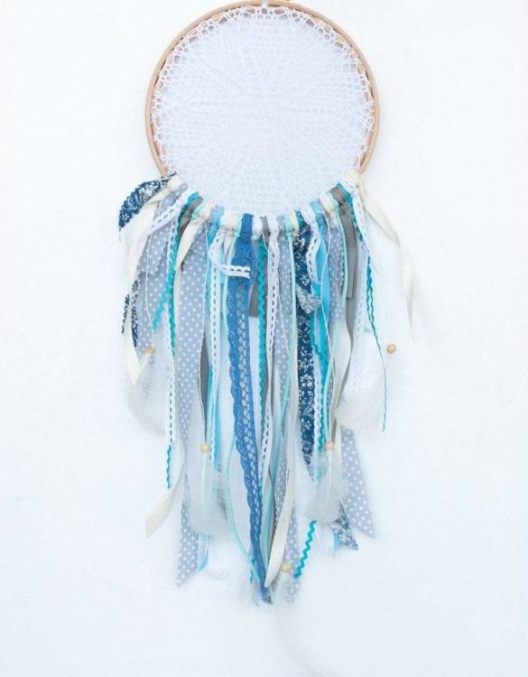 Perfect for a nursery or child's bedroom, the Blue Sky Handmade Dream Catcher looks great as a new baby gift or to hang in the baby's nursery. Dream catchers are totems that represent good energy, and neutralize negative energy at home.