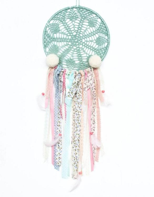 Perfect for a nursery or child's bedroom, the Creamy Pompons Handmade Dream Catcher looks great as a new baby gift or to hang in the baby's nursery. Dream catchers are totems that represent good energy, and neutralize negative energy at home.