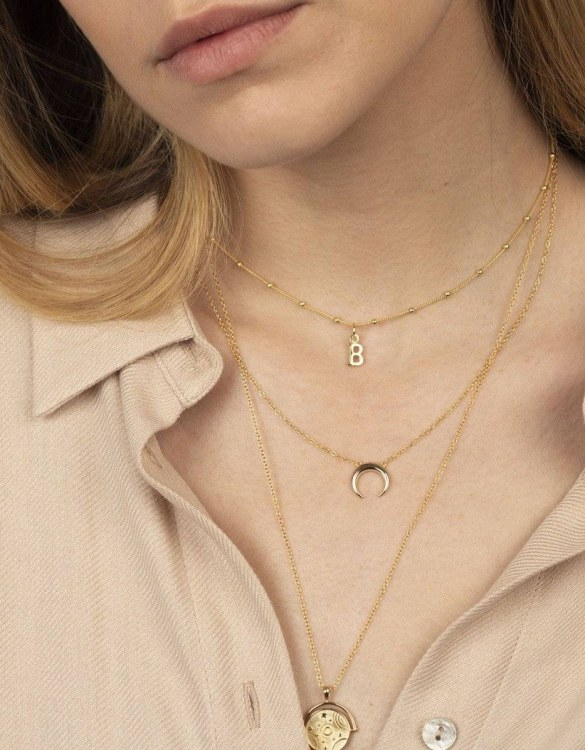 With a sleek, minimal and contemporary design, the Font Gold Necklace is the perfect everyday accessory for effortless elegance. This special sterling silver necklace has been designed to represent happiness, so whoever wears can be set on the path to joy.