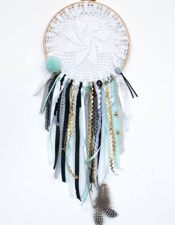 Perfect for a nursery or child's bedroom, the Gold Star Handmade Dream Catcher looks great as a new baby gift or to hang in the baby's nursery. Dream catchers are totems that represent good energy, and neutralize negative energy at home.
