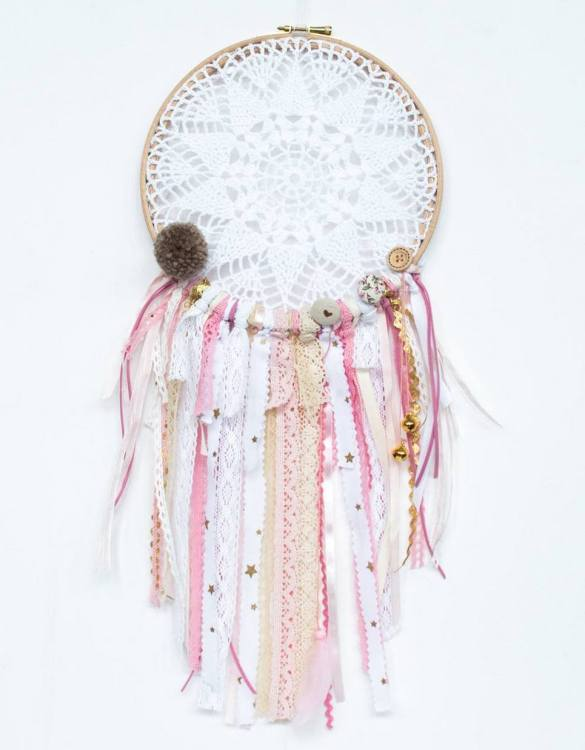 Perfect for a nursery or child's bedroom, the Golden Bells Handmade Dream Catcher looks great as a new baby gift or to hang in the baby's nursery. Dream catchers are totems that represent good energy, and neutralize negative energy at home.