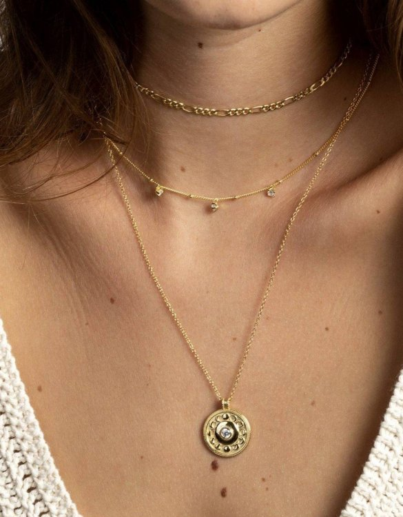 With a sleek, minimal and contemporary design, the Lunar Gold Necklace is the perfect everyday accessory for effortless elegance. This special sterling silver necklace has been designed to represent happiness, so whoever wears can be set on the path to joy.