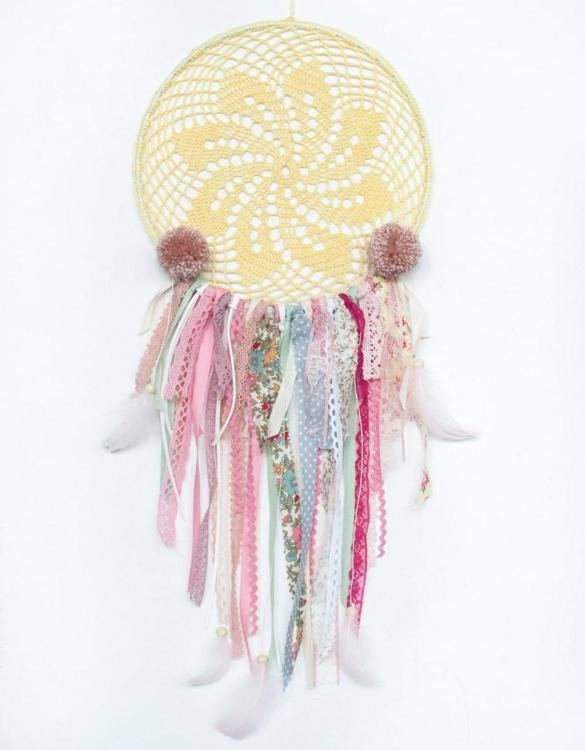 Perfect for a nursery or child's bedroom, the Summer Memory Handmade Dream Catcher looks great as a new baby gift or to hang in the baby's nursery. Dream catchers are totems that represent good energy, and neutralize negative energy at home.