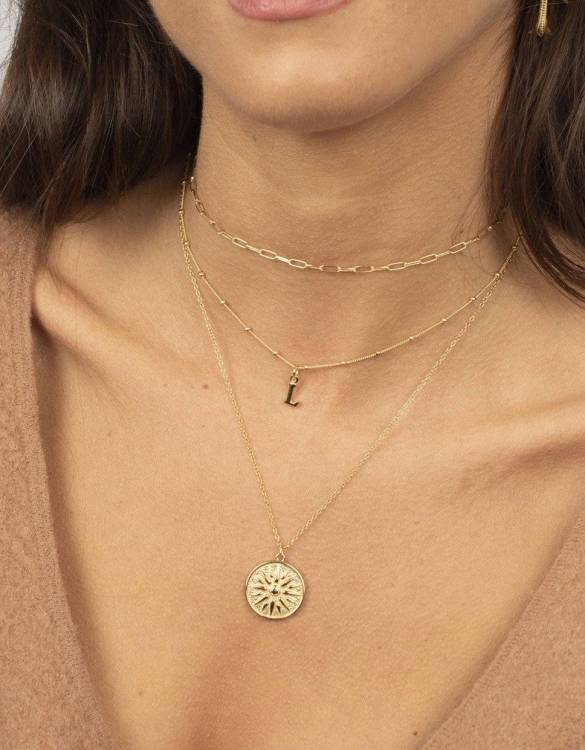 With a sleek, minimal and contemporary design, the Sun Medallion Gold Necklace is the perfect everyday accessory for effortless elegance. This special sterling silver necklace has been designed to represent happiness, so whoever wears can be set on the path to joy.