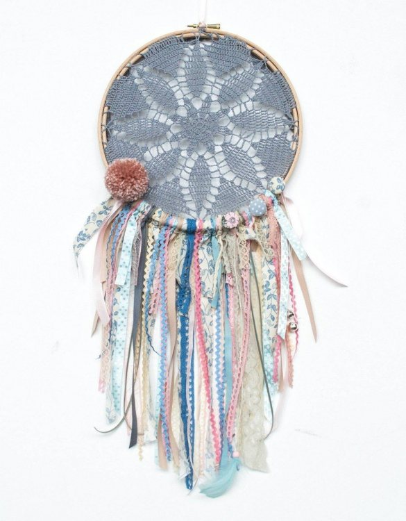 Perfect for a nursery or child's bedroom, the Whisper Handmade Dream Catcher looks great as a new baby gift or to hang in the baby's nursery. Dream catchers are totems that represent good energy, and neutralize negative energy at home.