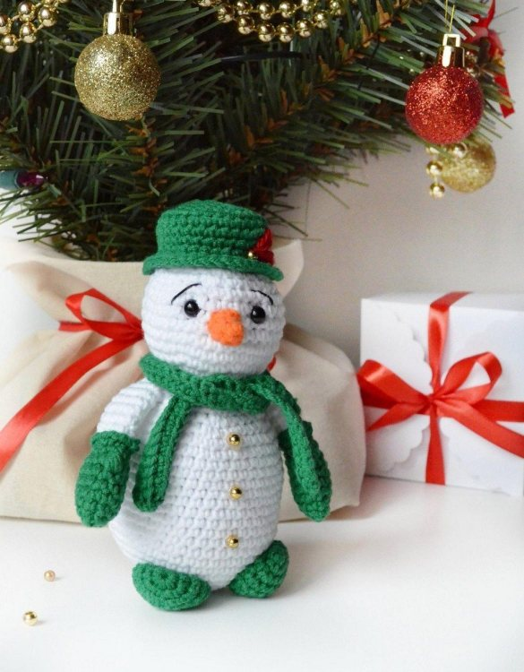 Strong and courageous, the Hand Knitted Christmas Snowman Children's Plush Toy will watch over your little one each night and be by their side through every adventure. A friend for life.