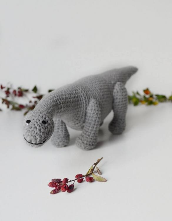 Strong and courageous, the Hand Knitted Diplodocus Children's Plush Toy will watch over your little one each night and be by their side through every adventure. A friend for life.
