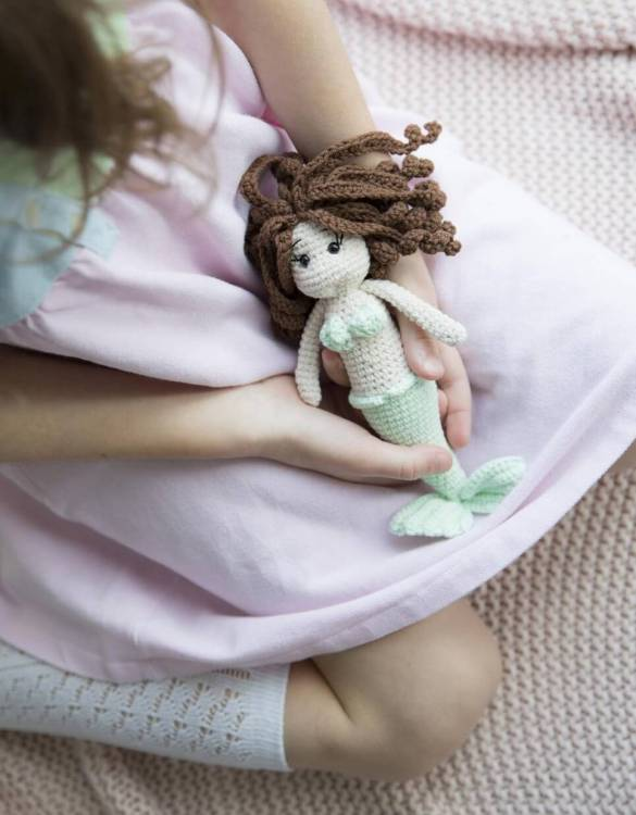 Strong and courageous, the Little Mermaid Curly Hair Doll will watch over your little one each night and be by their side through every adventure. A friend for life.
