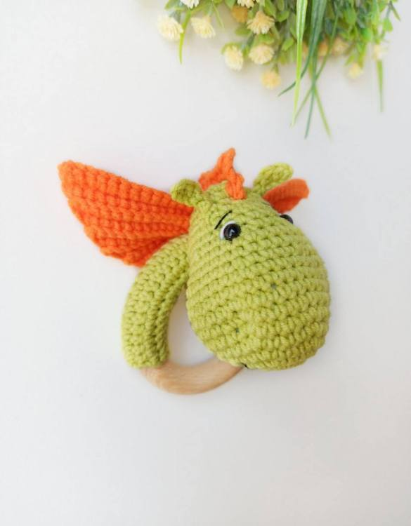 Absolutely adorable, the Personalised Dragon Baby Rattle Teether will provide hours of endless fascination. These cute little wooden baby rattles come with a wooden ring, which is perfect for baby play and to practice hand movement.