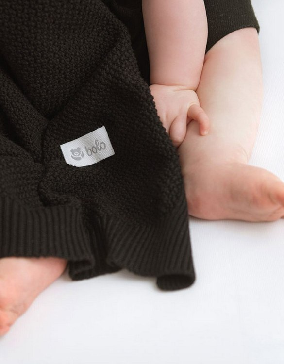 Chic and cozy, the Black Baby Cotton Blanket adds a playful touch that will catch your little one's attention. The super soft material of this hooded baby blanket, feels almost like felt and is perfect for wrapping a new bundle of joy up in and is the perfect way of welcoming a new baby home.