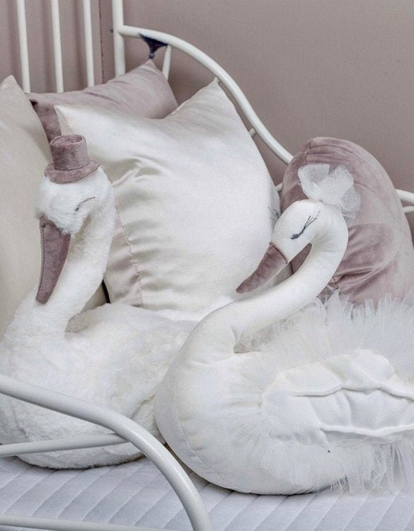 With a beautiful long curved neck and a graceful and pretty face, the Charlotte and Lucien - The Couple of Lovers Swans is a wonderful decoration for girl nursery. A soft swan decor that you'll love to hug.