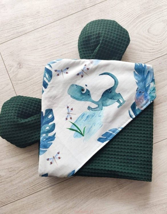 A charming towel to wrap your baby with after the bath, the Green Bottle Misio Hooded Baby Towel makes a very comfortable feel against baby's skin. This unique baby hooded towel is a definite must-have when completing a layette for a baby.