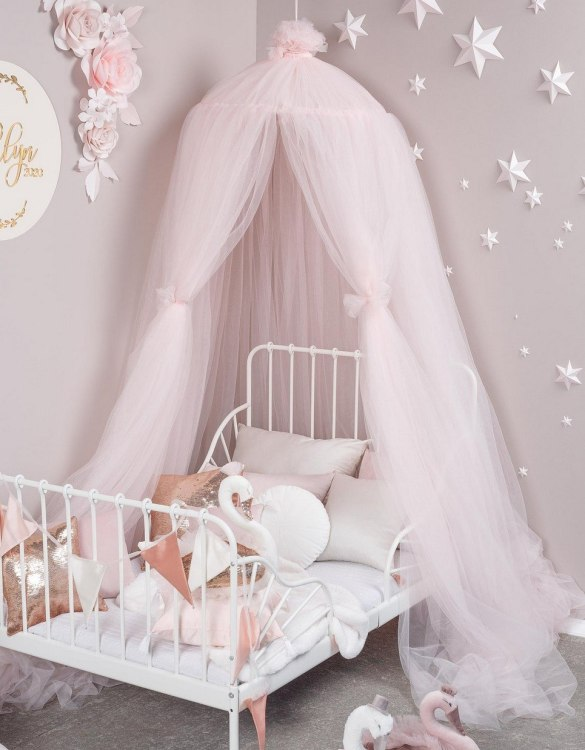 A magical space with whimsical charm, the Light Rose Tulle Bed Canopy is a perfect accent for the nursery room. Turn bedtime into a magical adventure with this charming children's bed canopy. An amazing place for children where they can sleep and play.