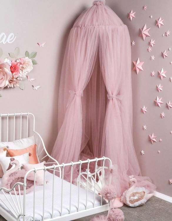 A magical space with whimsical charm, the Misty Rose Tulle Bed Canopy is a perfect accent for the nursery room. Turn bedtime into a magical adventure with this charming children's bed canopy. An amazing place for children where they can sleep and play.