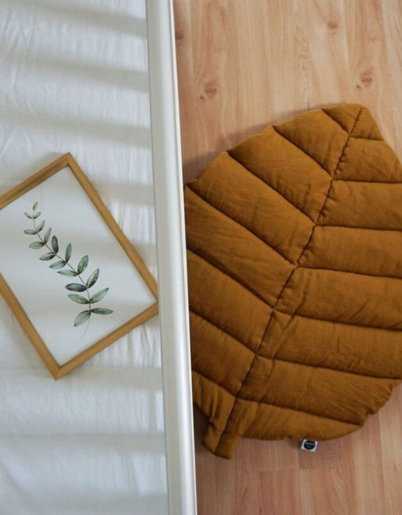 Perfect for tummy time for newborns and babies, the Mustard Linen Leaf Play Mat will make a lovely addition to any nursery as a decorative rug, or as a play mat in a nursery or playroom.