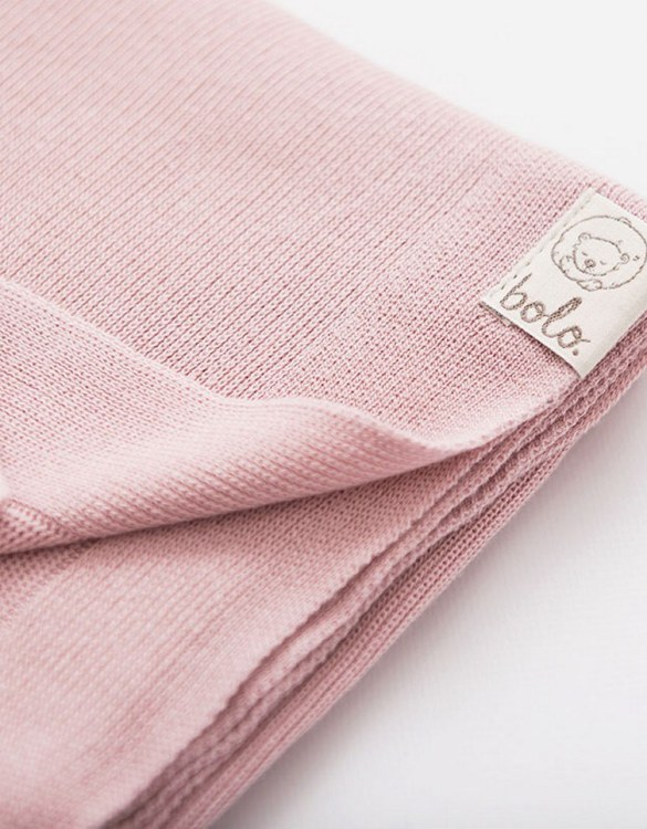Chic and cozy, the Pink Light Baby Bamboo Blanket adds a playful touch that will catch your little one's attention. The super soft material of this hooded baby blanket, feels almost like felt and is perfect for wrapping a new bundle of joy up in and is the perfect way of welcoming a new baby home.