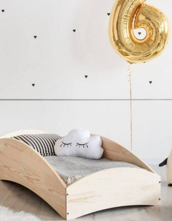 Turn bedtime into a magical adventure with the Scandinavian Wooden Bed. An amazing Montessori bed for children where they can sleep and play.