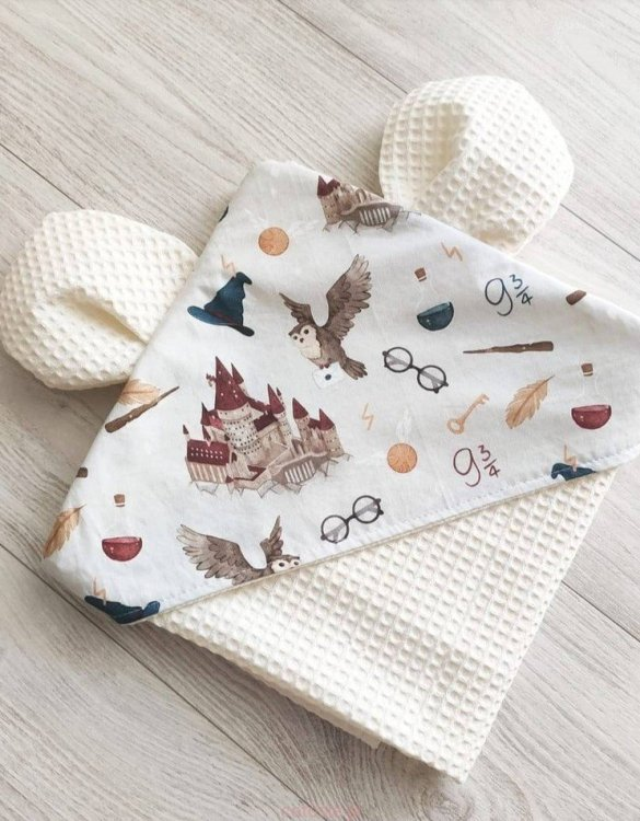 A charming towel to wrap your baby with after the bath, the School Of Magic Cream Hooded Baby Towel makes a very comfortable feel against baby's skin. This unique baby hooded towel is a definite must-have when completing a layette for a baby.