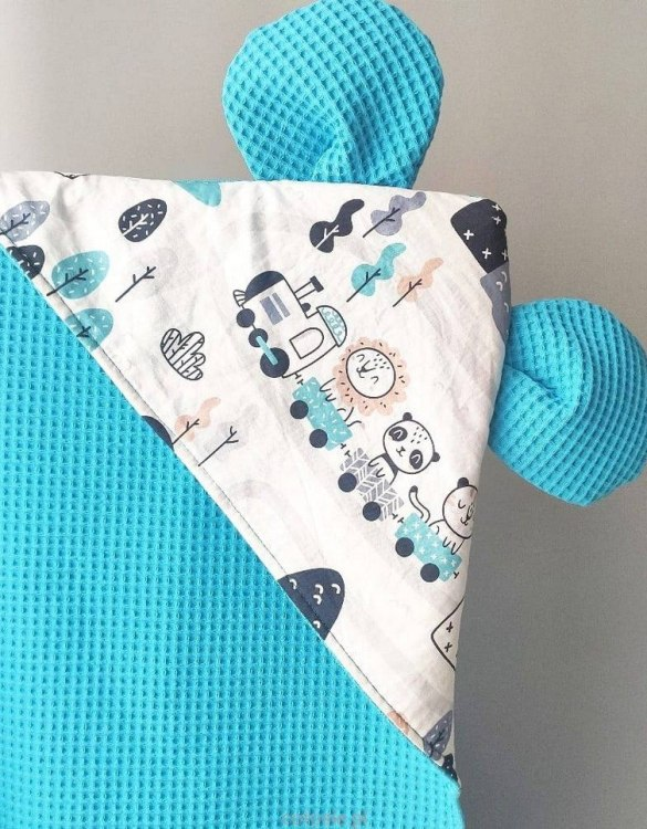 A charming towel to wrap your baby with after the bath, the Train Turquoise Hooded Baby Towel makes a very comfortable feel against baby's skin. This unique baby hooded towel is a definite must-have when completing a layette for a baby.