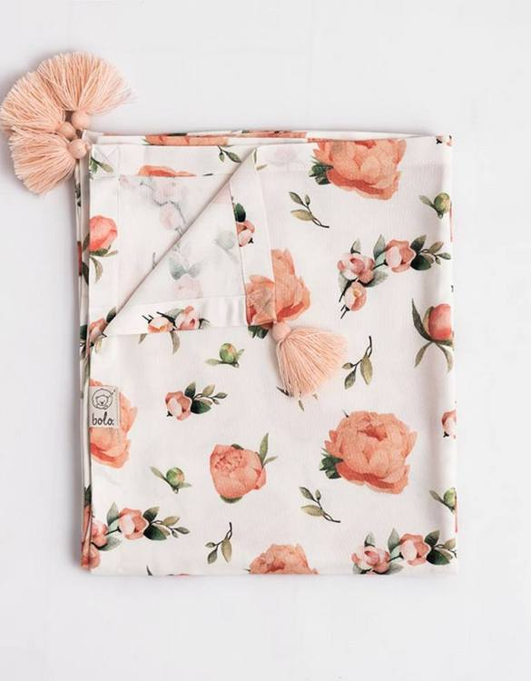 Giving a beautifully soft feel, the Peach Peonies Bamboo Swaddle Blanket is a lovely lightweight swaddle blanket for your little one. A gift that's sure to be spotted from all the rest.