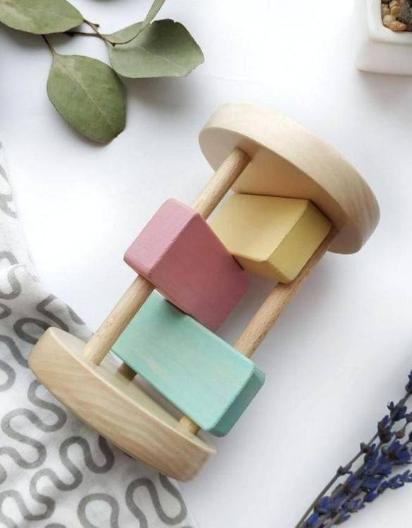 Bright and fun, the Wooden Montessori Baby Rattle for Girls is a gorgeous traditional wooden baby rattle with a colourful modern twist. A wonderfully tactile first toy which is perfect for little hands and minds.