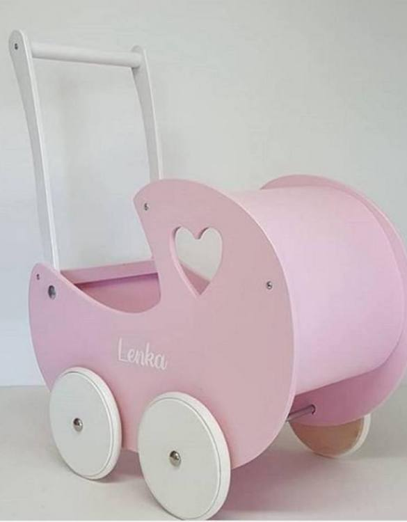 Allows you to carry dolls and teddy bears, the Girlish Heart Pink Personalised Wooden Doll Pram helps to learn to walk and improves acquired walking skills. A gorgeous toddler wooden doll pram made from wood with an option of adding your child's name and including bedding set: duvet, pillow and bedsheet.
