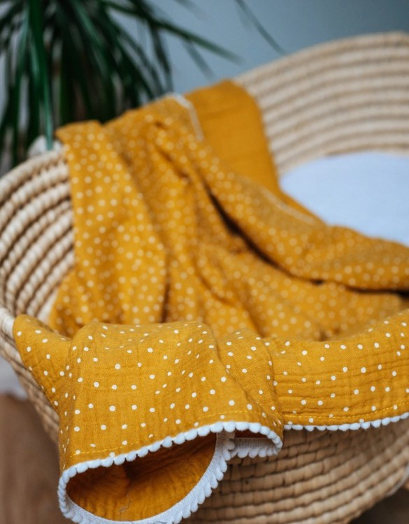 Treat your little one to cosy comfort, the Ocher Polka Dot Pompon Blanket will keep baby feeling secure and warm, perfect for keeping your baby comfortable when you're out and about. A tender wrap makes your baby feel safe and secure in the big, new world.