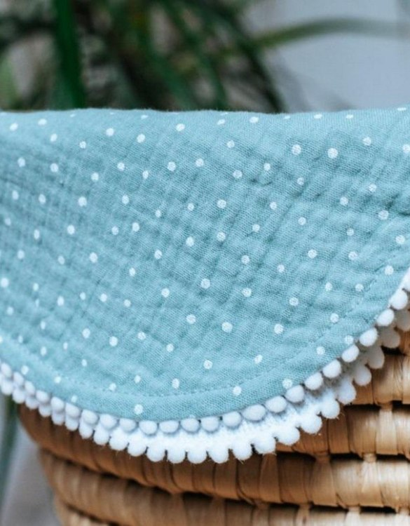Treat your little one to cosy comfort, the Sea Green Polka Dot Pompon Blanket will keep baby feeling secure and warm, perfect for keeping your baby comfortable when you're out and about. A tender wrap makes your baby feel safe and secure in the big, new world.