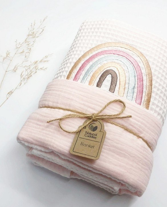Treat your little one to cosy comfort, the White - Pink Rainbow Waffle Blanket will keep baby feeling secure and warm, perfect for keeping your baby comfortable when you're out and about. A tender wrap makes your baby feel safe and secure in the big, new world.