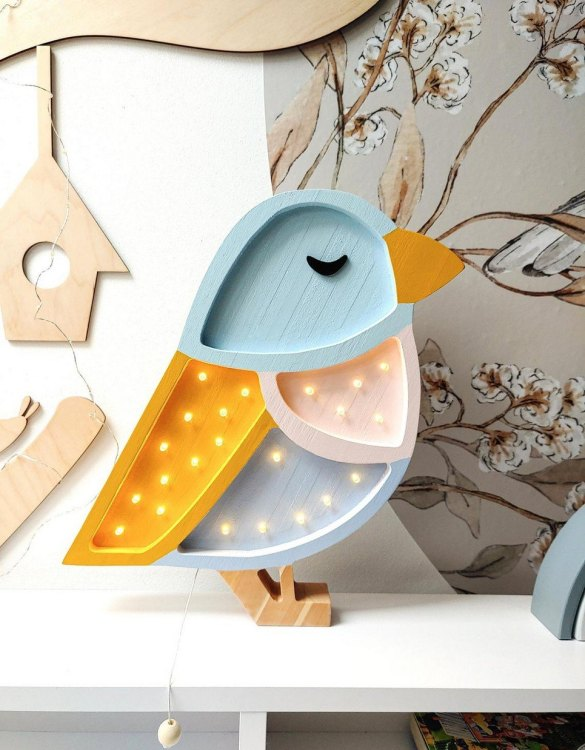 Creating a special and warming atmosphere in your bedroom, the Wooden Sparrow Lamp is ideal for a night light or as a gift. Our Sparrow lamp will be your perfect companion while singing lullabies. With its presence and warm light, it will certainly help you fall asleep.