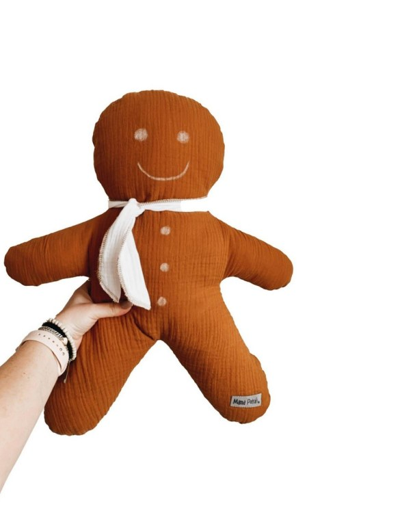 Perfect for any little one or teenager's bedroom, the Gingerbread Man Pillow is great for finishing up your little one's playroom. Your kids will love it! This children's cushion is super soft and super cute. A beautiful addition to any nursery or kids' room.
