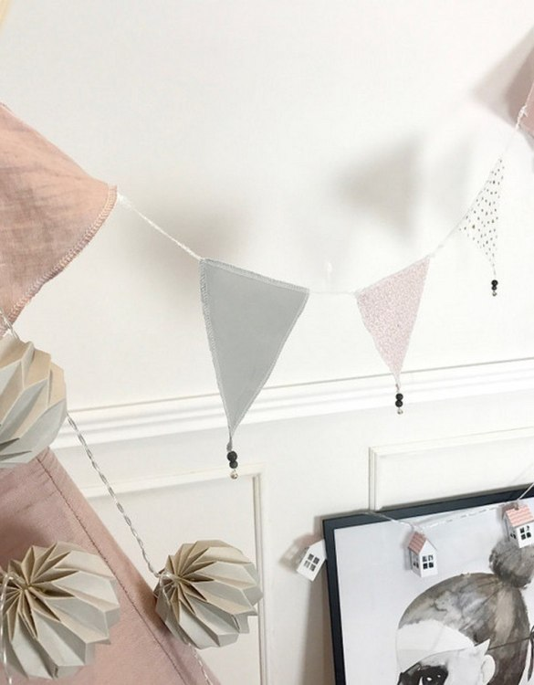 The ideal gift for a new baby or a Christening present, the Triangle Bunting Powder Pink makes a fab addition to a party or a little one's room. A gentle garland will decorate your nursery room and contribute to the development of the baby.