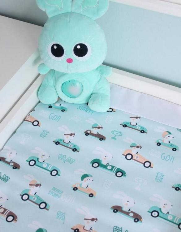 A perfect gift for a new baby, the Rabbits On The Mint Waterproof Winding Matis ideal for keeping the little one comfortable and snuggly while changing. Super practical and stylish with a waterproof lining and it comes in your favourite prints.