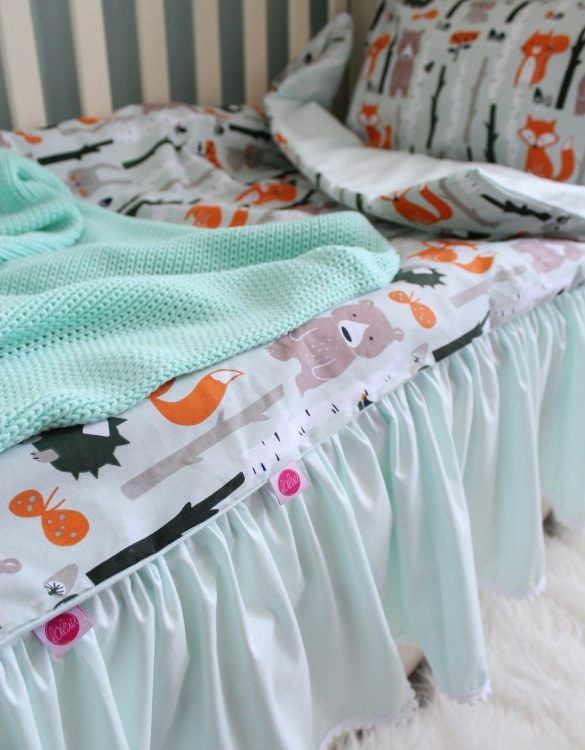 Special decoration of every baby cot, the Mint Crib Bed Skirt covers the space between the drawer and the bottom of the cot and mattress.