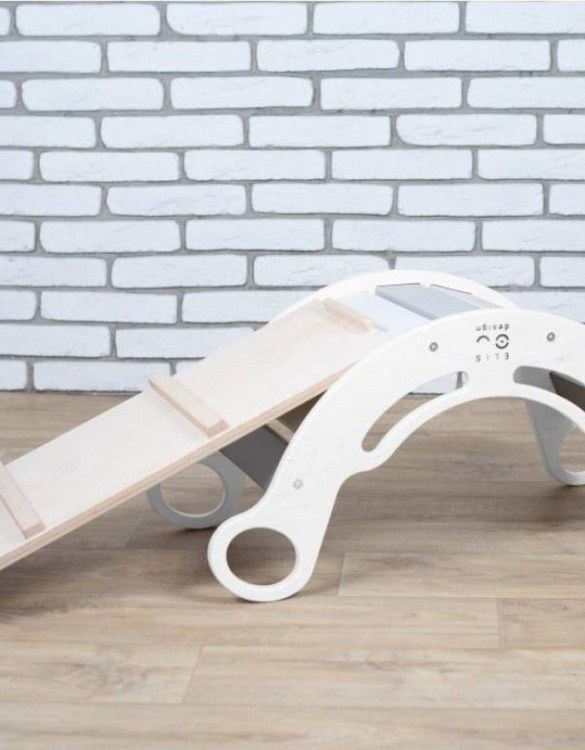 A great choice for playtime, the White with Rainbow Montessori Balance Board and Plank will quickly become your household's most beloved toy as well. This rocking toy will stimulate your toddler's senses, awaken their imagination, strengthen muscles and will promote the development of balance.