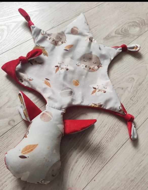 A cuddly toy designed mainly for babies, the Red Dragon Moons Doudou Baby Comforter is soft, cuddly, breathable, and perfect for little hands to hold. It is perfect to snuggle with in their stroller or crib, and as the little ones grow up, it will continue to be by their side.