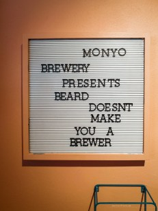Monyo brewery sign that says: Monyo Brewery Presents Beard Doesn't Make You A Brewer