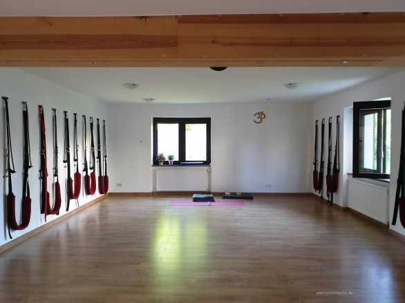 A small room in the yoga studio I was attending in Gdansk. It's empty and quiet right before the classes started in the morning and the light comes through a window in the centre.