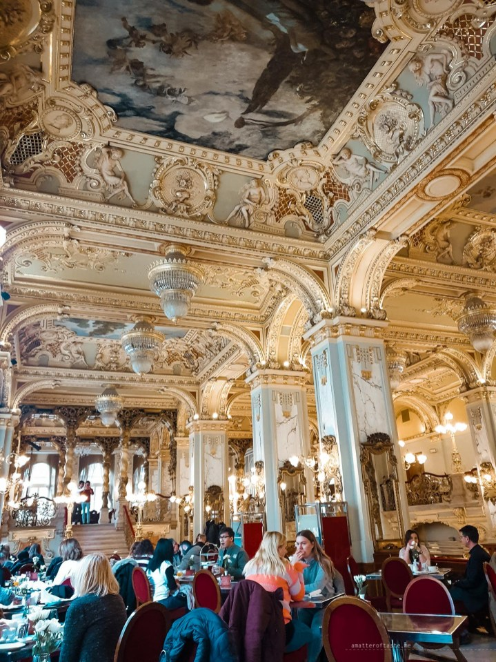 the oh-so-lavish interior of the New York Cafe in Budapest. There is more gold than you could ever imagine painted all over the walls and ceilings.