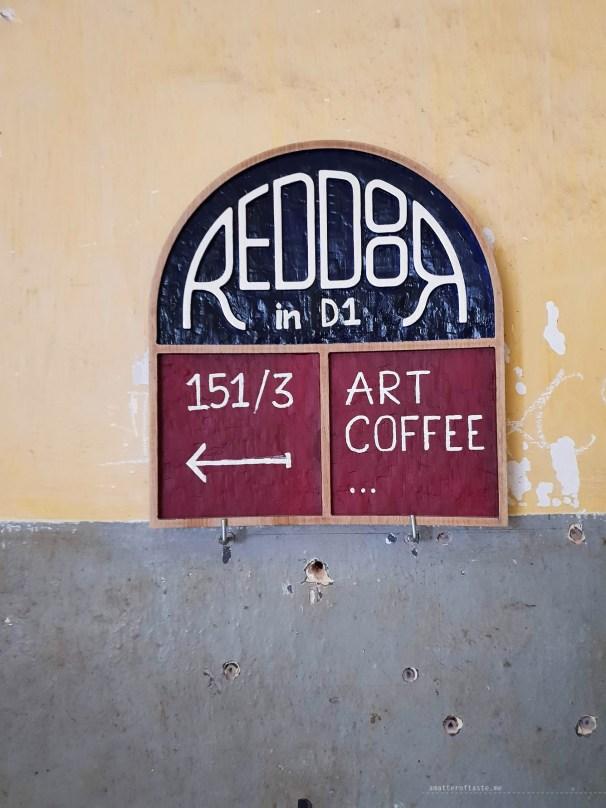 red door cafe HCMC sign